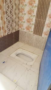 This is a clean squat toilet, most are not this nice.